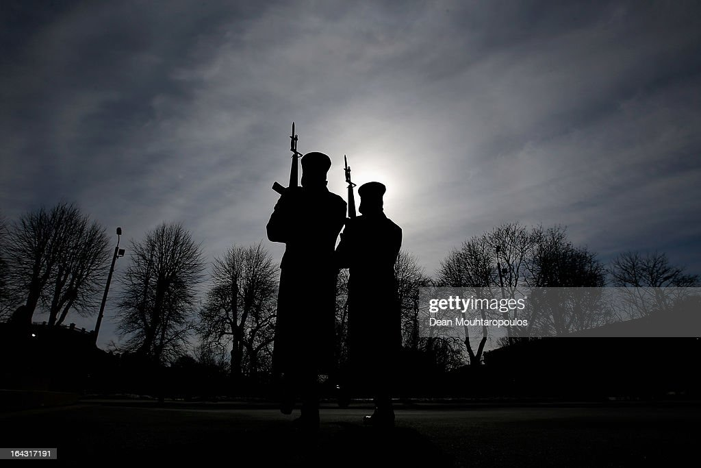 Guards from The Honor of the Headquarters Battalion of the National Armed Forces are pictured in front of The Freedom Monument honouring soldiers killed during the Latvian War of Independence from1918 to 1920 on March 21, 2013 in Riga, Latvia.