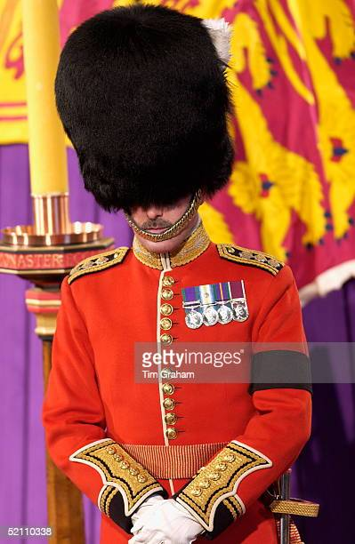 Guards From The Household Division Welsh Guards Wearing Traditional Bearskin Hats And Their Medals Stood Vigil With Heads Bowed And Wearing Black...