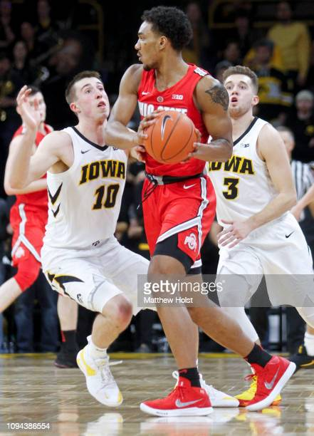 Guards Joe Wieskamp and Jordan Bohannon of the Iowa Hawkeyes defend in the second half against guard Musa Jallow of the Ohio State Buckeyes on...