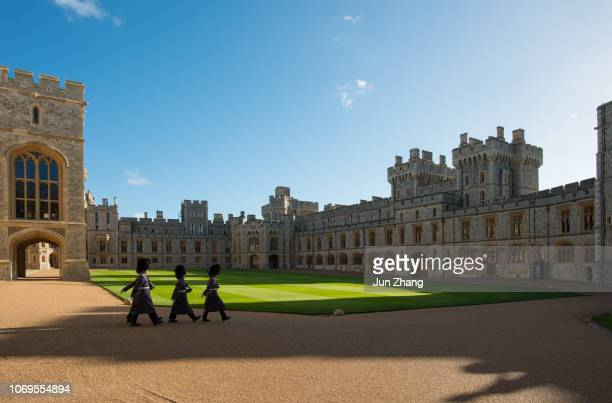 guards march in the quadrangle of windsor castle, england - windsor castle stock pictures, royalty-free photos & images