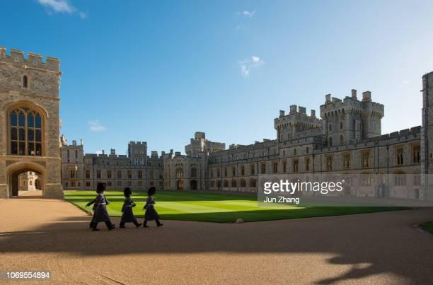 guards march in the quadrangle of windsor castle, england - castello di windsor foto e immagini stock