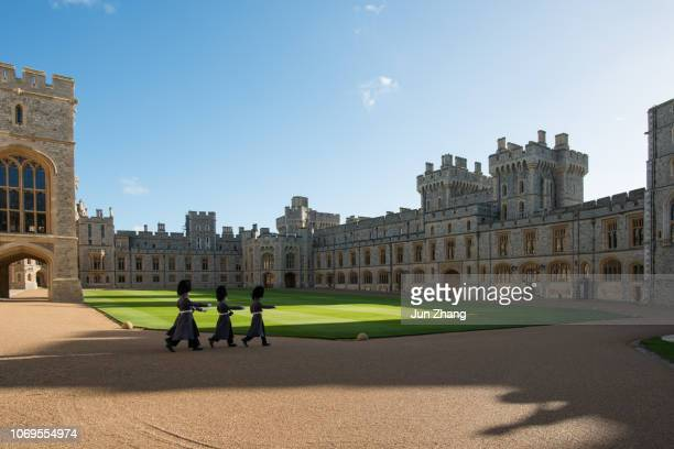 guards march in the quadrangle of windsor castle, england - windsor england stock pictures, royalty-free photos & images