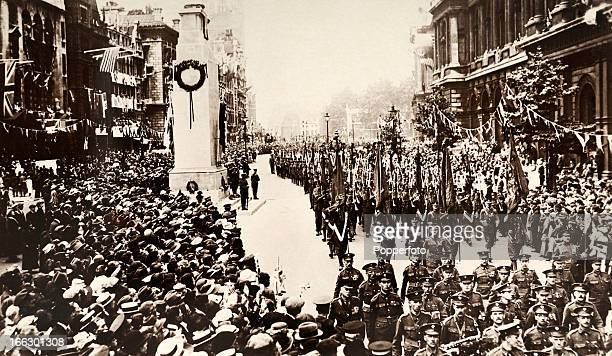 Guards marching past the Cenotaph in Whitehall during the Victory March and Peace Pageant following the conclusion of World War One held in London on...