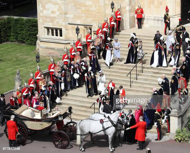 Guards military other members of the Royal family and The Knights of the Garter look on as Queen Elizabeth II walks down the steps to her carriage...