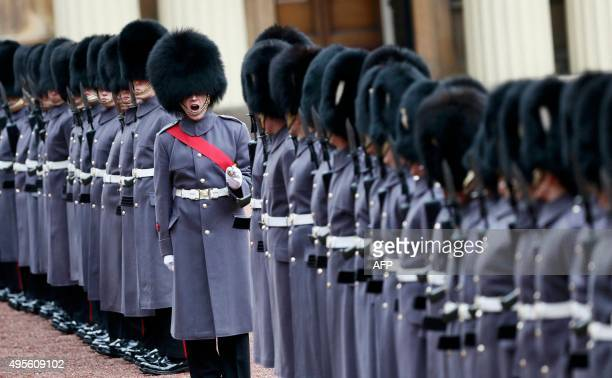 Guards of honour line up for the inspection of Kazakhstan's President Nursultan Nazarbayev at Buckingham Palace in London on November 4 2015 Britain...