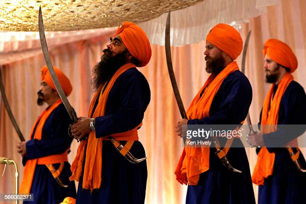 Guards of the altar Punch Piyare pose with swords on stage where Sikhs prayed and donated money Estimated 15000 Sikhs in Los Angeles celebrated...