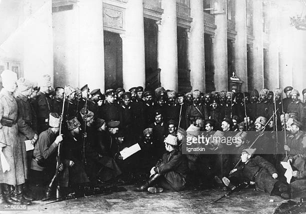 Guards of the Tavrichesky Palace listening to the reading of Izvestia in Petrograd read by Bolsheviks to convince them of the rights of their...
