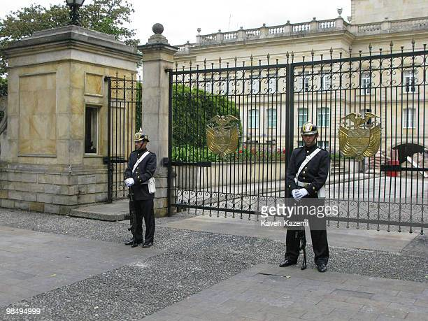 Guards on duty stand outside presidential palace located in old part of the city Bogota formerly called Santa Fe de Bogota is the capital city of...