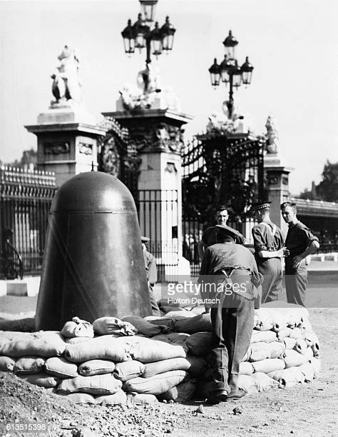 Guards on sentry duty in the forecourt of Buckingham Palace and at Marlborough House have been provided with steel pillbox sentry boxes as an airraid...