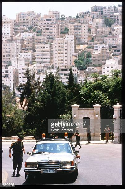 Guards patrol a plaza May 17 1998 in Amman Jordan Still a teenager when crowned in 1952 King Hussein has led the young Arab nation through brief...