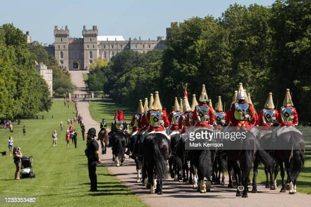 Guards proceed along the Long Walk towards Windsor Castle for a dress rehearsal for Trooping the Colour on 9th June 2021 in Windsor, United Kingdom....