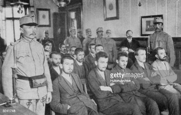 Guards stand alongside seated members of the Bosnian liberation group 'Young Bosnia' during the trial of their member Gavrilo Princip who was...