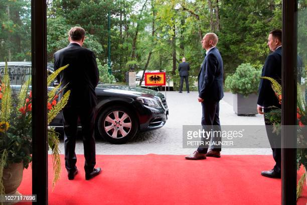 Guards stand as the car of German President FrankWalter Steinmeier arrives for a meeting of the heads of six German speaking countries in Sils Maria...