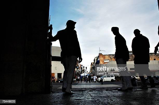 Guards stand at the entrance to La Puerta del Conde in El Parque Independencia October 29, 2006 in Santo Domingo, Dominican Republic. This is the...