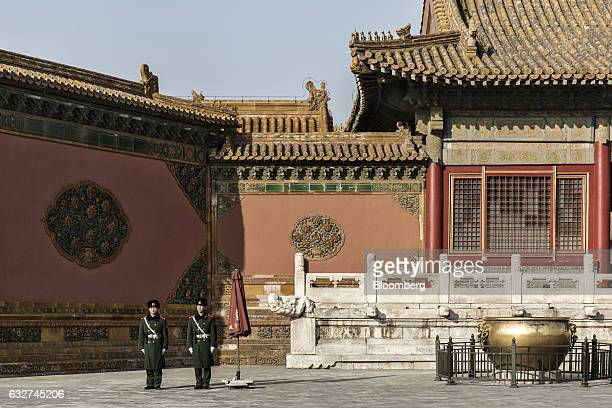 Guards stand in a courtyard inside the Palace Museum at the Forbidden City in Beijing China on Thursday Nov 24 2016 Beijings Palace Museum receives...