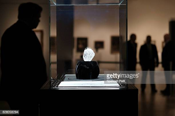 Guards stand next to the 1109carat rough Lesedi La Rona diamond the biggest rough diamond discovered in more than a century at Sotheby's on May 04...