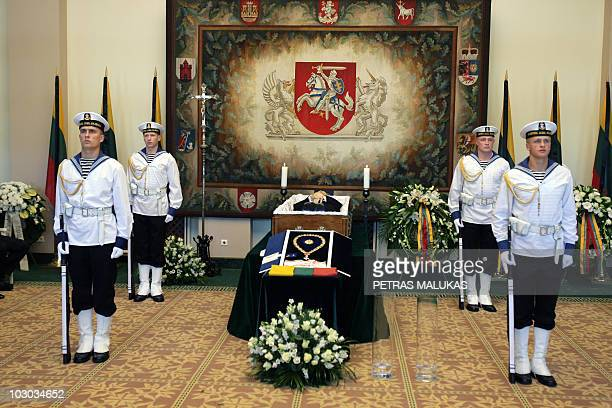 Guards stand next to the coffin of the late Lithuanian President Algirdas Brazauskas at the President palace in Vilnius Lithuania on June 29 2010...