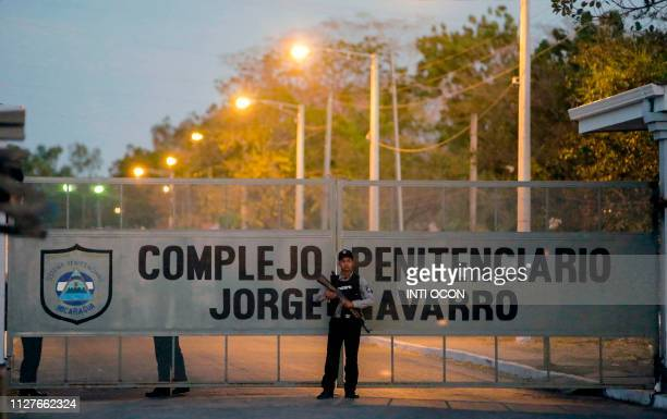 Guards stand outside Jorge Navarro prison known as The Model in Tipitapa Managua on February 26 2019 Mothers of alleged political prisoners who...