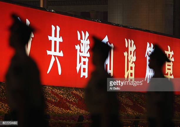Guards stand to attention at Tianamen Square during the Opening Ceremony for the 2008 Beijing Summer Olympics at Tiananmen Square on August 8 2008 in...