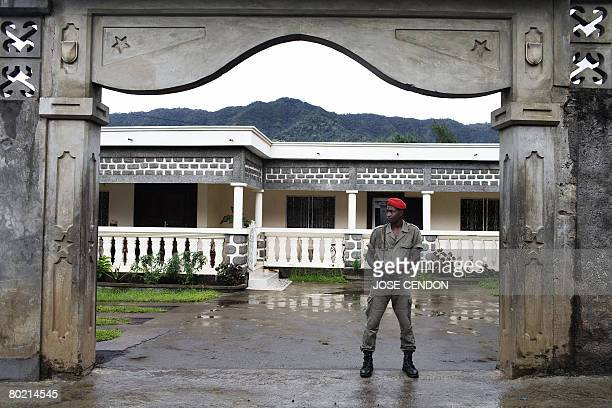 A guards stands in front of the house of renegade Anjouan President Mohamed Bacar before an interview with AFP on March 12 2008 in Hoani near...