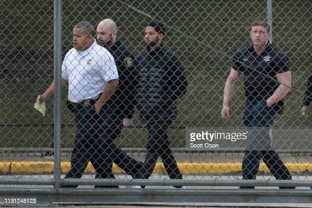 Guards walk with Empire actor Jussie Smollett before he is released on bond from Cook County jail on February 21 2019 in Chicago Illinois Smollett...