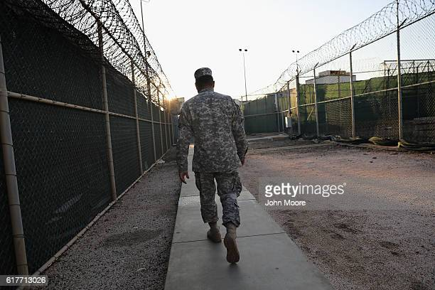 "Guards walks into the ""Gitmo"" maximum security detention center on October 22, 2016 at the U.S. Naval Station at Guantanamo Bay, Cuba. The U.S...."