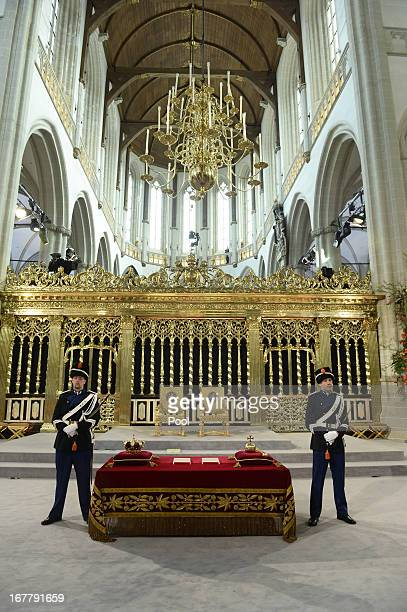 Guards watch over the regalia at the credencetable prior to the inauguration of HM King Willem Alexander of the Netherlands and HRH Princess Beatrix...