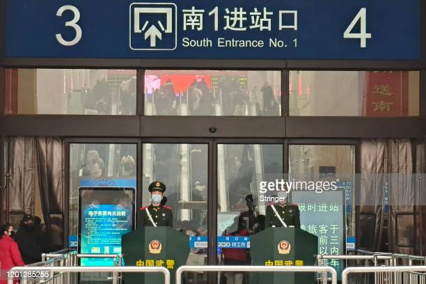 Guards wearing face masks stand at Hankou Railway Station on January 22 2020 in Wuhan China A new infectious coronavirus known as 2019nCoV was...