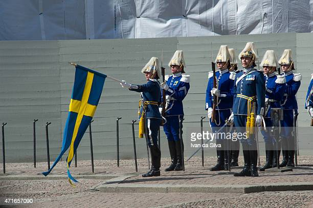 Guards with flag are seen during the celebration of the King's birthday at Palace Royale on April 30 2015 in Stockholm Sweden