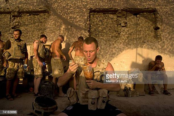 Guardsman Ashley O'Sullivan a British Soldiers from the Grenadier Guards eats his food cooked by one of them to break the routine of the military...