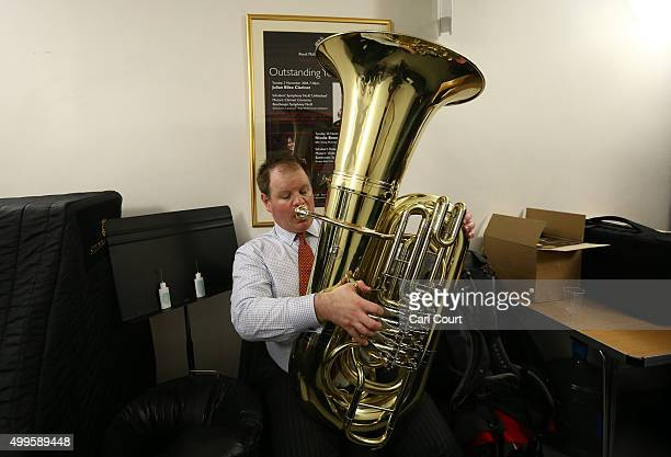 Guardsman checks his Tuba ahead of a practice session at Cadogan Hall on December 2 2015 in London England Musicians from all seven of the Regimental...