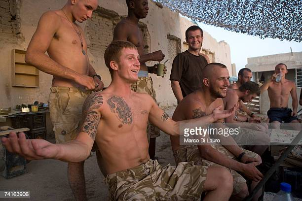 Guardsman Daniel Probyn a British Soldier from the Grenadier Guards gestures as he talks to his fellow troops in his down time on May 14 2007 in...