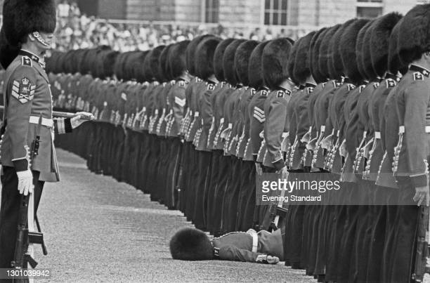 Guardsman faints during a rehearsal for the Trooping the Colour ceremony in London, UK, 26th May 1973.