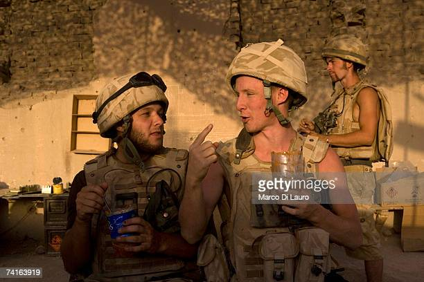 Guardsman Scott Blaney and Guardsman Ashley O'Sullivan British Soldiers from the Grenadier Guards eat their food cooked by one of them to break the...