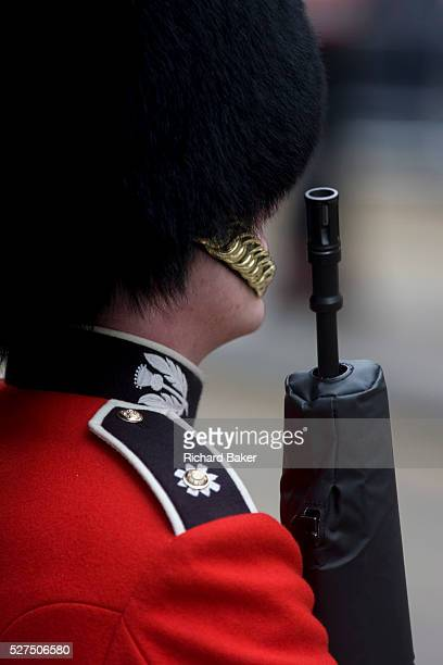 A guardsman stands to attention before the funeral of Margaret Thatcher Draped in the union flag and mounted on a gun carriage the coffin of...