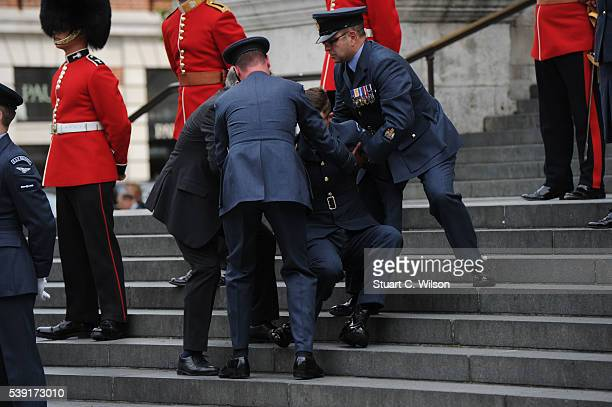 A guardsman stumbles during a National Service of Thanksgiving as part of the 90th birthday celebrations for The Queen at St Paul's Cathedral on June...