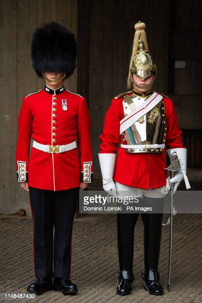 Guardsman Thomas Dell of the Grenadier Guards and his twin brother Trooper Ben Dell of the Household Cavalry who will both take part in the Trooping...