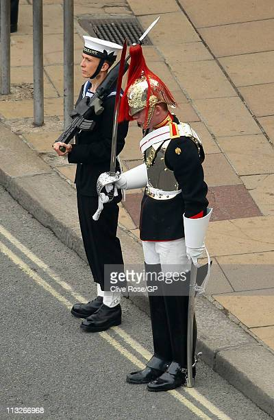 Guardsman who fell from his mount looks on as TRH Prince William Duke of Cambridge and Catherine Duchess of Cambridge leave Westminster Abbey after...