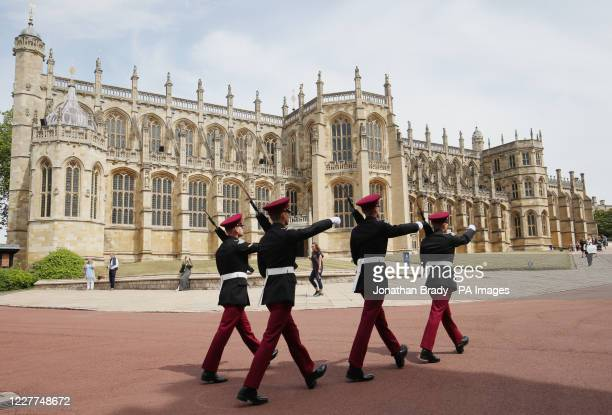 Guardsmen from the Queen's Royal Hussars march past St. George's Chapel at Windsor Castle which has reopened to the public after the lifting of...