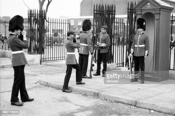 Guardsmen' have a snapshot of themselves at the 'Wellington Barracks' set at Pinewood Studios during the filming of 'The Breaking of Bumbo' 10th...