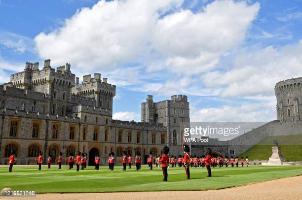 Guardsmen keep social distance as they stand in formation for a ceremony to mark Britain's Queen Elizabeth's official birthday at Windsor Castle on...