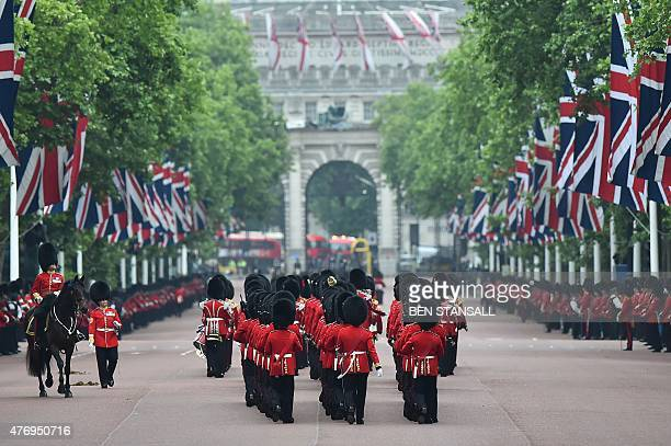 Guardsmen march along the Mall away from Buckingham Palace during the Queen's Birthday Parade 'Trooping the Colour' in London on June 13 2015 The...