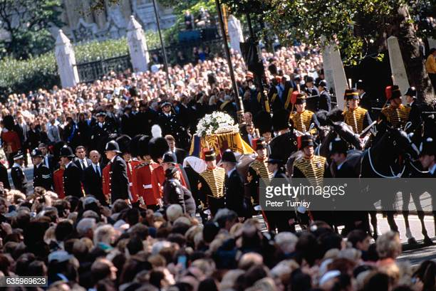 Guardsmen of the Prince of Wales Company of the Welsh Guards attend the casket along the route of the funeral procession of Diana Princess of Wales...
