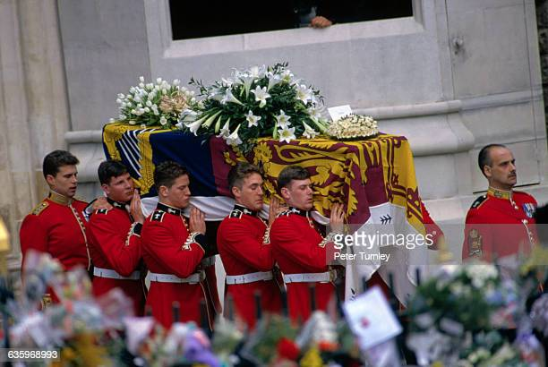 Guardsmen of the Prince of Wales Company of the Welsh Guards carry Diana's casket out of Westminster Abbey following the funeral of Diana Princess of...