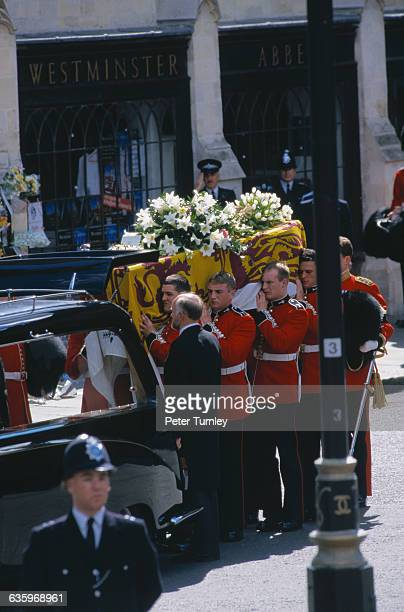 Guardsmen of the Prince of Wales Company of the Welsh Guards put Diana's casket in a hearse after the funeral of Diana Princess of Wales only seven...