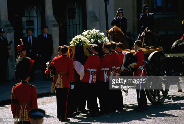 Guardsmen of the Prince of Wales Company of the Welsh Guards unload Diana's casket from a carriage during the funeral of Diana Princess of Wales only...