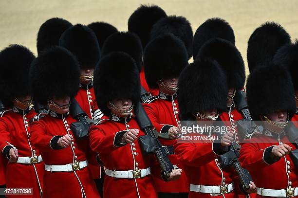 Guardsmen of the Scots Guards march onto Horse Guards Parade in central London on May 10 2015 during an armed forces and veterans' parade to mark the...