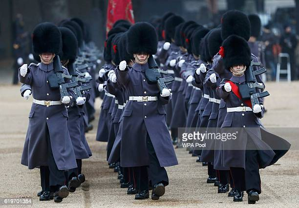 Guardsmen prepare to take part in a ceremonial welcome for Colombia's President Juan Manuel Santos and his wife Maria Clemencia de Santos at Horse...