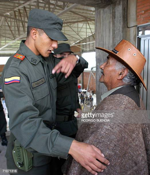 A Policeman talks with a citizen 28 May 2006 in a poll station in Guasca Colombia during the presidential elections in Colombia A total of 267...