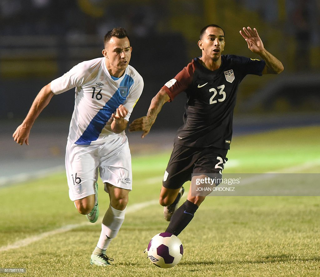 Guatamala's Marco Papa (L) and USA's Edgar Castillo run for the ball during their Russia 2018 FIFA World Cup Concacaf Qualifiers' football match, in Guatemala City, on March 25, 2016.